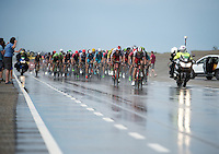 """a large 2nd peloton (1'20"""" behind) with yellow jersey Rohan Dennis (AUS/BMC) & some overall contenders such as Nairo Quintana (COL/Movistar) &  Alejandro Valverde (ESP/Movistar) racing over the very wet Brouwersdam<br /> <br /> stage 2: Utrecht - Neeltje Jans (166km)<br /> 2015 Tour de France"""