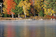 Shore of Newfound Lake from Wellington State Park in Bristol, New Hampshire USA during the autumn months