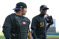 May 3, 2010:  Starting pitcher Aroldis Chapman (51) of the Louisville Bats walks to the dugout with catcher Corky Miller prior to a game vs. the Buffalo Bisons at Coca-Cola Field in Buffalo, NY.   Louisville defeated Buffalo by the score of 20-7, Chapman got the win on the mound.  Photo By Mike Janes/Four Seam Images