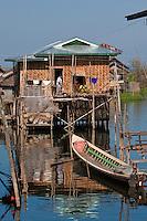 Myanmar, Burma.  Village Scene, House on Stilts, Transport by Boat, Inle Lake, Shan State.