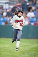 Great Falls Voyagers bat girl Sarah hustles off the field during the game against the Helena Brewers at Centene Stadium on August 19, 2017 in Helena, Montana.  The Voyagers defeated the Brewers 8-7.  (Brian Westerholt/Four Seam Images)
