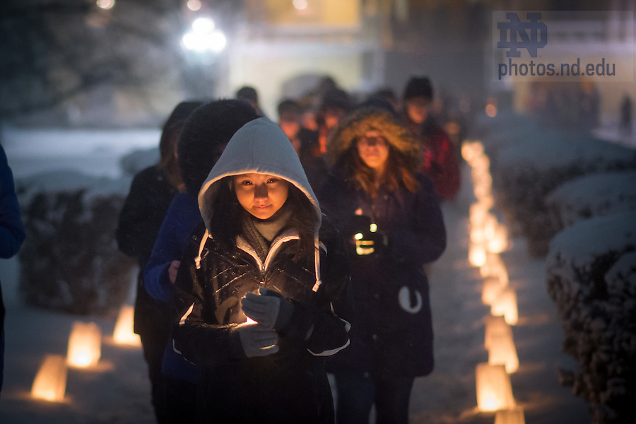 Jan. 18, 2016; Students and staff walk out of the Main Building after a midnight prayer service in honor of the Rev. Martin Luther King Jr. holiday.  The service was the inaugural event of a campus-wide Walk the Walk Week observance, during which students, faculty and staff have been asked to reflect on the values central to Martin Luther King Jr.'s legacy and the mission of Notre Dame. (Photo by Matt Cashore/University of Notre Dame)