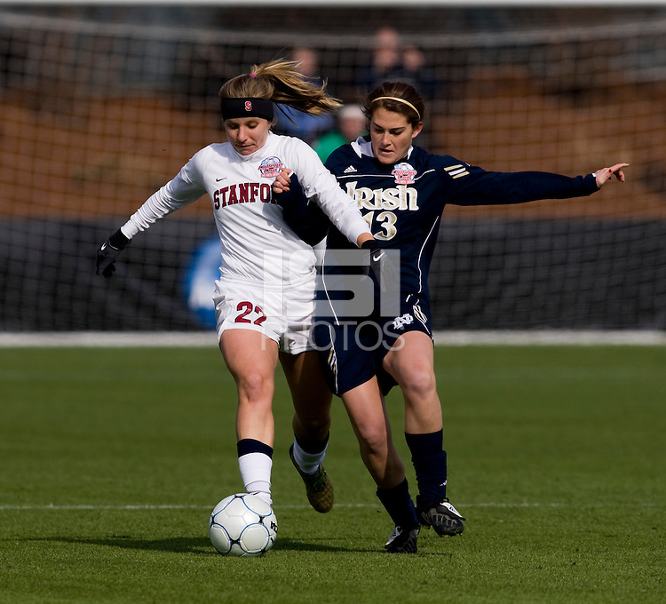 Allison McCann (22) of Stanford fights for the ball with Courtney Barg (13)  of Notre Dame during the final of the NCAA Women's College Cup at WakeMed Soccer Park in Cary, NC.  Notre Dame defeated Stanford, 1-0.