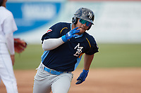 Yohendrick Pinango (15) of the Myrtle Beach Pelicans hustles towards third base against the Lynchburg Hillcats at Bank of the James Stadium on May 23, 2021 in Lynchburg, Virginia. (Brian Westerholt/Four Seam Images)