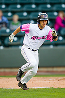 Joey DeMichele (18) of the Winston-Salem Dash hustles down the first base line against the Wilmington Blue Rocks at BB&T Ballpark on April 20, 2013 in Winston-Salem, North Carolina.  The Dash defeated the Blue Rocks 4-2 in game one of a double-header.  (Brian Westerholt/Four Seam Images)