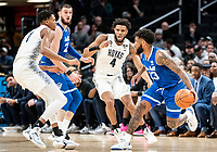 WASHINGTON, DC - FEBRUARY 05: Myles Powell #13 of Seton Hall holds the ball away from Jagan Mosely #4 of Georgetown during a game between Seton Hall and Georgetown at Capital One Arena on February 05, 2020 in Washington, DC.