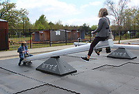 Edna Stanley (right) gets airborne as she and Dora Poage play on the Impulse seesaws installation at the Amazeum.<br />