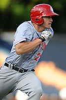 Hagerstown Suns right fielder Brandon Miller #20 runs to first during a game against the Asheville Tourists at McCormick Field on May 28, 2013 in Asheville, North Carolina. The Tourists won the game 9-4. (Tony Farlow/Four Seam Images)