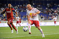 Luke Rodgers (9) of the New York Red Bulls plays the ball as Robbie Russell (3) of Real Salt Lake defends. Real Salt Lake defeated the New York Red Bulls 3-1 during a Major League Soccer (MLS) match at Red Bull Arena in Harrison, NJ, on September 21, 2011.