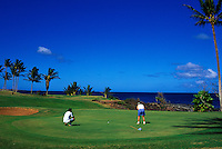 People playing at Kaluakoi golf course number 11 found on Molokai