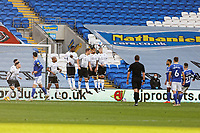 Harry Wilson of Cardiff City (R) takes a free kick over a Swansea wall during the Sky Bet Championship match between Cardiff City and Swansea City at the Cardiff City Stadium, Cardiff, Wales, UK. Saturday 12 December 2020