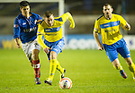 Cowdenbeath v St Johnstone ..17.12.12      Scottish Cup.Paddy Cregg pulls away from Lewis Milne.Steven MacLean and Joseph Mbu.Picture by Graeme Hart..Copyright Perthshire Picture Agency.Tel: 01738 623350  Mobile: 07990 594431