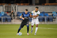 SAN JOSE, CA - SEPTEMBER 16: Vako #11 of the San Jose Earthquakes is marked by Andy Polo #7 of the Portland Timbers during a game between Portland Timbers and San Jose Earthquakes at Earthquakes Stadium on September 16, 2020 in San Jose, California.