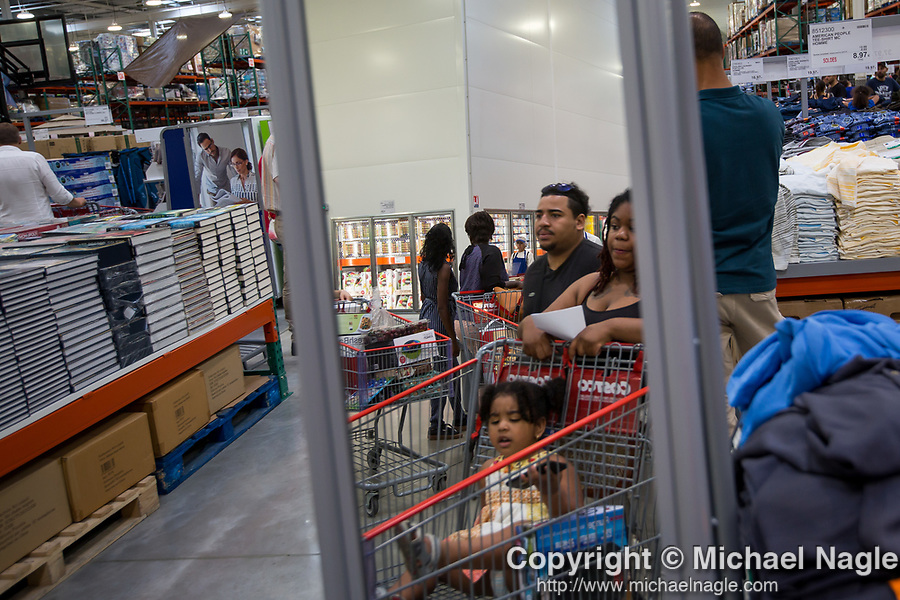 Costco Wholesale Corp. members shop at a newly opened Costco warehouse in Villebon-Sur-Yvette, France, on Saturday, July 7, 2018. The 150,000-square foot warehouse, which opened last month just outside of Paris, is Costco's first store in France. Costco plans to open 15 more warehouses in France by 2025. Photograph by Michael Nagle