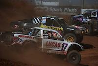 Apr 16, 2011; Surprise, AZ USA; LOORRS driver Carl Renezeder (17) races alongside Kyle Leduc (99) during round 3 at Speedworld Off Road Park. Mandatory Credit: Mark J. Rebilas-.