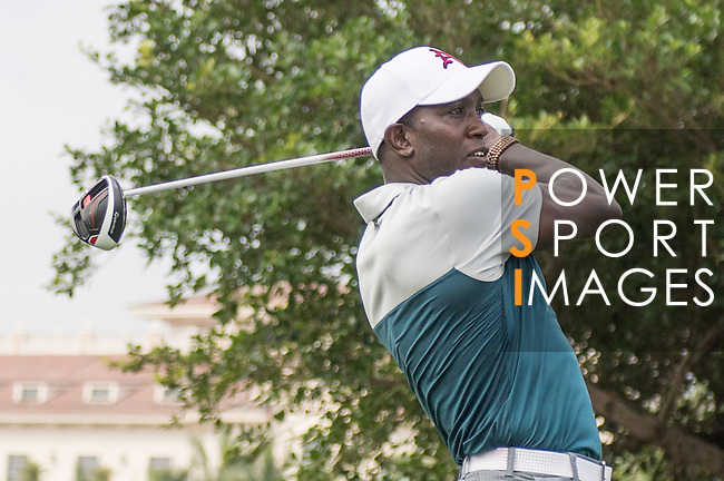 Dwight Yorke tees off the 1st hole during the World Celebrity Pro-Am 2016 Mission Hills China Golf Tournament on 23 October 2016, in Haikou, China. Photo by Weixiang Lim / Power Sport Images