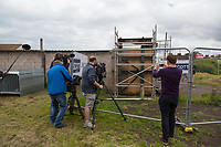 Pictured: Contractors on site. Tuesday 28 May 2019<br /> Re: Contractors are working to move Banksy's Season Greeting, now owned by John Brandler, which appeared on a garage wall in Port Talbot, to a new location in the same town in south Wales, UK.