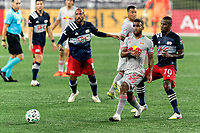 FOXBOROUGH, MA - AUGUST 29: Cristian Casseres Jr #23 of New York Red Bulls passes the ball as Cristian Penilla #70 of New England Revolution  defends during a game between New York Red Bulls and New England Revolution at Gillette Stadium on August 29, 2020 in Foxborough, Massachusetts.