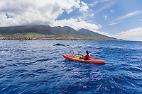 A kayaker has a close encounter with a humpback whale off the coast of Maui.