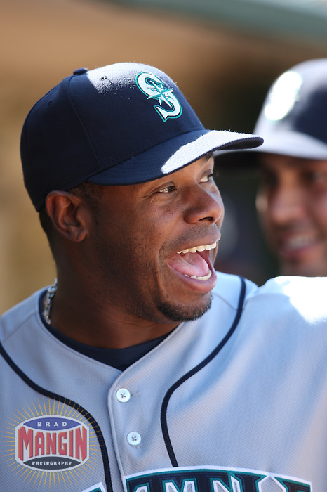 OAKLAND, CA - APRIL 11:  Ken Griffey Jr. of the Seattle Mariners jokes around in the dugout during the game against the Oakland Athletics at the Oakland-Alameda County Coliseum in Oakland, California on Saturday, April 11, 2009.  The Mariners defeated the A's 8-5.  Photo by Brad Mangin