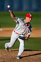 Michael Hoppes #24 of the Nebraska Cornhuskers pitches against the Cal State Fullerton Titans at Goodwin Field on February 16, 2013 in Fullerton, California. Cal State Fullerton defeated Nebraska 10-5. (Larry Goren/Four Seam Images)