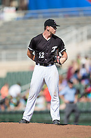 Kannapolis Intimidators relief pitcher Ian Hamilton (12) looks to his catcher for the sign against the Greensboro Grasshoppers at Intimidators Stadium on July 17, 2016 in Greensboro, North Carolina.  The Intimidators defeated the Grasshoppers 3-2 in game one of a double-header.  (Brian Westerholt/Four Seam Images)