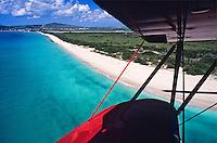 Flying over Sandy Point Wildlife Refuge.in a red bi-plane.St. Croix.U.S. Virgin Islands