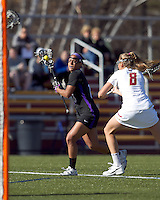 University at Albany midfielder Allie Phelan (18) on the attack. University at Albany defeated Boston College, 11-10, at Newton Campus Field, on March 30, 2011.