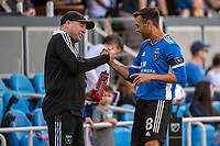 SAN JOSE, CA - JULY 24: Chris Wondolowski #8 of the San Jose Earthquakes greets a staff member before a game between San Jose Earthquakes and Houston Dynamo at PayPal Park on July 24, 2021 in San Jose, California.