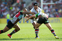 Sam Tuitupou of Sale Sharks is tackled by Jordan Turner-Hall (left) and George Lowe of Harlequins during the Aviva Premiership match between Harlequins and Sale Sharks at The Twickenham Stoop on Saturday 15th September 2012 (Photo by Rob Munro)