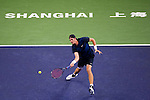 SHANGHAI, CHINA - OCTOBER 13:  John Isner of USA returns a ball to Roger Federer of Switzerland during day three of the 2010 Shanghai Rolex Masters at the Shanghai Qi Zhong Tennis Center on October 13, 2010 in Shanghai, China.  (Photo by Victor Fraile/The Power of Sport Images) *** Local Caption *** John Isner