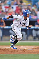 Asheville Tourists shortstop Carlos Herrera (2) runs to first base during a game against the Charleston RiverDogs at McCormick Field on July 4, 2017 in Asheville, North Carolina. The Tourists defeated the RiverDogs 2-1. (Tony Farlow/Four Seam Images)