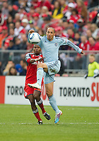 Sporting KC midfielder Ryan Smith #11 and Toronto FC defender Danleigh Borman #25 in action during an MLS game between Sporting Kansas City and the Toronto FC at BMO Field in Toronto on June 4, 2011...