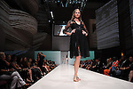 A model walks the runway wearing Carmen Marc Valvo at the second night of Fashion Houston at the Wortham Theater Monday Oct. 10,2011.(Dave Rossman/For the Chronicle)