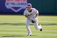 Tim Bodine (12) of the Evansville Purple Aces fields a ball hit to right field during a game against the Indiana State Sycamores in the 2012 Missouri Valley Conference Championship Tournament at Hammons Field on May 23, 2012 in Springfield, Missouri. (David Welker/Four Seam Images)