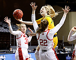 SIOUX FALLS, SD - MARCH 8: Heaven Hamling #11 of the North Dakota State Bison shoots against the defense of Chloe Lamb #22 of the South Dakota Coyotes during the Summit League Basketball Tournament at the Sanford Pentagon in Sioux Falls, SD. (Photo by Richard Carlson/Inertia)