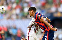 AUSTIN, TX - JULY 29: Miles Robinson #12 of the United States heads the ball away from his goal during a game between Qatar and USMNT at Q2 Stadium on July 29, 2021 in Austin, Texas.