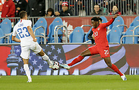 TORONTO, ON - OCTOBER 15: Jonathan David #20 of Canada and Aaron Long #23 of the United States battle for a ball during a game between Canada and USMNT at BMO Field on October 15, 2019 in Toronto, Canada.