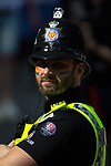 © Joel Goodman - 07973 332324 . 26/08/2017. Manchester , UK. A policeman working during the 2017 Pride parade through Manchester City Centre . The annual festival , which is the largest of its type in Europe , celebrates LGBT life . Photo credit : Joel Goodman