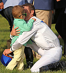 LEXINGTON, KY - April 13, 2018. Jockey Julien Leparoux greets his son after winning the Maker's 46 Mile on #6 Heart to Heart.<br /> #6 Heart to Heart and jockey Julien Leparoux win the 30th running of the Maker's 46 Mile Grade 1 $300,000 for owner Terry Hamilton and trainer Brian Lynch at Keeneland Race Course.  Lexington, Kentucky. (Photo by Candice Chavez/Eclipse Sportswire/Getty Images)