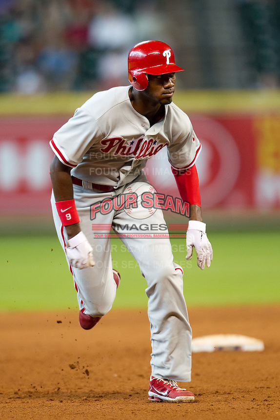 Philadelphia Phillies outfielder Domonic Brown #9 heads to third base during the Major League baseball game against the Houston Astros on September 16th, 2012 at Minute Maid Park in Houston, Texas. The Astros defeated the Phillies 7-6. (Andrew Woolley/Four Seam Images).