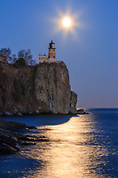 """""""Super Moon Radiance""""<br /> <br /> The December (near) full Cold Moon rose through a pastel palette on the eve of the Supermoon. As it gained altitude near Split Rock Lighthouse, the radiant moon painted a peaceful scene over Lake Superior."""