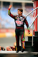 Driver Jeff Gordon waves to the crowds during opening ceremonies of the Coca-Cola Classic 900 NASCAR Race at the Lowe's Motor Speedway, in Concord, NC, held on Memorial Day 2009 (the race was delayed a day because of rain). Driver David Reutimann won his first Cup race during the rain-shortened event, held May 25, 2009. NASCAR's longest scheduled race went only 227 laps, or 340.5 miles, before officials ended it because of rain. The 2009 race was the 50th running of the Coca-Cola 600. Ryan Newman and Robby Gordon finished second and third respectively.