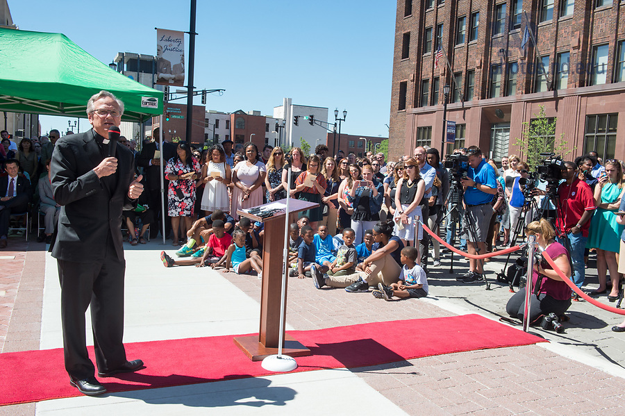 June 21, 2017; University of Notre Dame president Rev. John I. Jenkins, C.S.C., speaks at the unveiling of the new sculpture of the Rev. Theodore M. Hesburgh and the Rev. Martin Luther King in downtown South Bend.  (Photo by Barbara Johnston/University of Notre Dame)