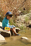 Sawyer catching minnows in the river at Dinosaur Valley State Park