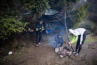 roadside fans trying to get warm up the extremely wet, cold & misty Cole di Mortirolo <br /> <br /> Stage 16: Lovere to Ponte di Legno (194km)<br /> 102nd Giro d'Italia 2019<br /> <br /> ©kramon