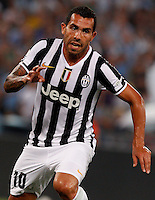 Calcio, Supercoppa di Lega: Juventus vs Lazio. Roma, stadio Olimpico, 18 agosto 2013<br /> Juventus forward Carlos Tevez, of Argentina, celebrates after scoring during the Italian League Supercup football final match between Juventus and Lazio, at Rome's Olympic stadium,  18 August 2013.<br /> UPDATE IMAGES PRESS/Riccardo De Luca