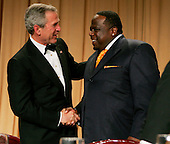 United States President George W. Bush greets Cedric The Entertainer during the annual White Hosue Correspondents' Association dinner at the Washington Hilton in Washington, D.C., Saturday 30 April 2005. The annual dinner began in 1914 as a bridge between the White House and its media corps and tonight feautured a mix of political insiders including Supreme Court Justices, Antonin Scalia and Stephen Breyer, and Hollywood elite such as Goldie Hawn and Richard Gere. <br /> Credit: Katie Falkenberg - Pool via CNP