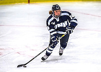 2 February 2013: University of New Hampshire Wildcat defender Megan Armstrong, a Freshman from Edina, MN, in action against the University of Vermont Catamounts at Gutterson Fieldhouse in Burlington, Vermont. The Lady Wildcats defeated the Lady Catamounts 4-2 in Hockey East play. Mandatory Credit: Ed Wolfstein Photo