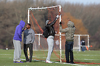 Irawo Reds FC players put up the goal nets before a Hackney & Leyton League Sunday Football match at East Marsh, Hackney Marshes - 31/01/10 - MANDATORY CREDIT: Gavin Ellis/TGSPHOTO - Self billing applies where appropriate - Tel: 0845 094 6026